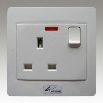 England standard three pin socket and small button switch with light